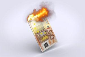 自国の紙幣が燃えるイラスト